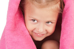 Smiling little girl wrapped in a pink towel Stock Photo