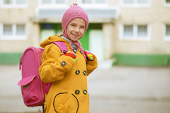 Smiling little girl in yellow coat Stock Photography