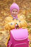 Smiling little girl in yellow coat Royalty Free Stock Image