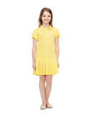 Smiling little girl in yellow dress Royalty Free Stock Images