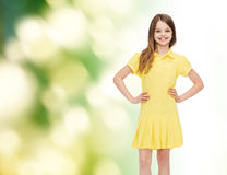 Smiling little girl in yellow dress Royalty Free Stock Photos