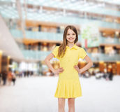 Smiling little girl in yellow dress Royalty Free Stock Photography