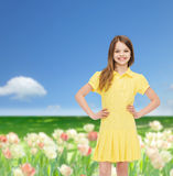 Smiling little girl in yellow dress Stock Image