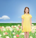 Smiling little girl in yellow dress Stock Images