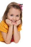 Smiling little girl in a yellow shirt Royalty Free Stock Photos