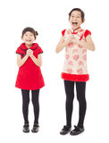 Smiling little girls with congratulation. Happy chinese new year. smiling little girls with congratulation gesture Stock Image