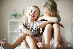 Smiling little girls at home. stock photos