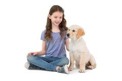Smiling little girls sitting next to dog Stock Image