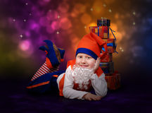 Smiling little gnome with gift boxes Royalty Free Stock Photos