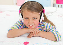 Smiling little gril listening to music Stock Images
