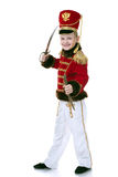 Smiling little hussar posing at camera Royalty Free Stock Photos