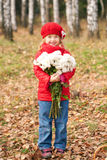 Smiling little kid with bouquet. Of white flowers for the mother Stock Photo