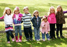 Smiling little kids outside Royalty Free Stock Photography