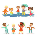 Smiling little kids playing on puddles, set for label design. Active leisure for children. Cartoon detailed colorful stock illustration