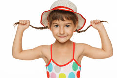Smiling little playing with her braids Royalty Free Stock Photos