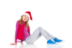 Smiling Little Santa Girl Looking Up Stock Photos