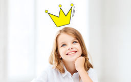 Smiling little school girl with crown. Education, childhood, people and school concept - smiling little school girl daydreaming at school with crown doodle Stock Images