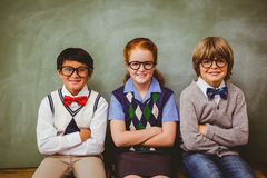 Smiling little school kids in classroom Royalty Free Stock Image