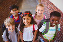 Smiling little school kids in school corridor Royalty Free Stock Photography