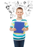 Smiling little student boy with blue book Stock Photos