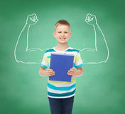 Smiling little student boy with blue book royalty free stock photography