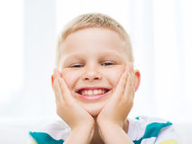 Smiling little student boy at home Stock Images