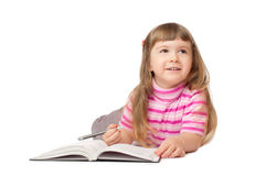 Smiling little writing girl Royalty Free Stock Photography