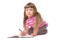 Smiling little writing girl Royalty Free Stock Photos