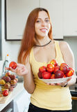 Smiling long-haired girl with nectarines Stock Photo