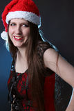 Smiling long haired santa girl Stock Photo