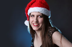 Smiling long haired santa girl Stock Image