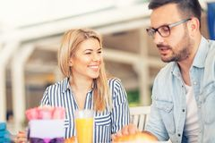 Smiling love couple nice talking during breakfast. Happy girl looking in her boyfriend royalty free stock photography