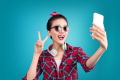 Smiling lovely active asian girl taking selfie photo. Stock Photo