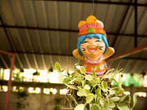 Smiling lovely Thai Greeting Clay doll for welcome Royalty Free Stock Photos