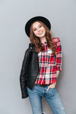 Smiling lovely woman wearing plaid shirt and leather jacket Royalty Free Stock Images