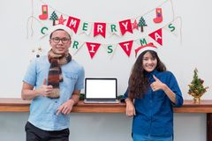 Smiling Lover asian couple thumbs up and standing at Christmas g royalty free stock images
