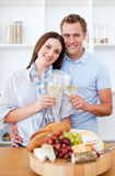 Smiling lovers drinking white wine Royalty Free Stock Photos