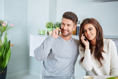 Smiling lovers in front of invoices Stock Image