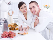 Smiling lovers in the kitchen Stock Photography