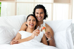 Smiling lovers toasting with Champagne Stock Images
