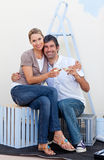 Smiling lovers toasting with Champagne. In their new house Stock Image