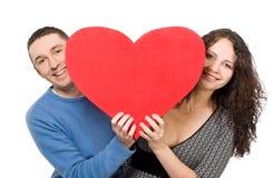 Smiling Loving Couple Holding Heart Stock Photos