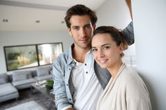 Smiling loving young couple at home Stock Images