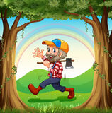 A smiling lumberjack walking at the forest Royalty Free Stock Photo