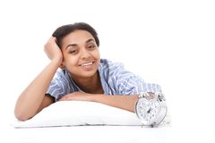 Smiling lying mulatto girl on pillow Royalty Free Stock Photography