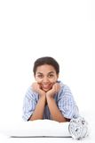 Smiling lying mulatto girl on pillow Stock Images