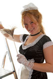 Smiling maid with a feather duster Stock Image