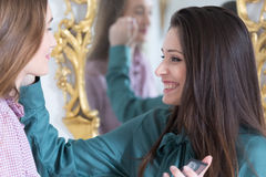 Smiling make-up artist working with model Stock Photo