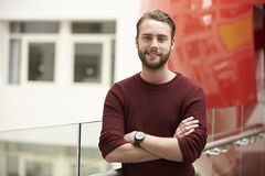 Smiling male adult student in modern university building Royalty Free Stock Image