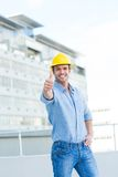 Smiling male architect gesturing thumbs up Stock Images